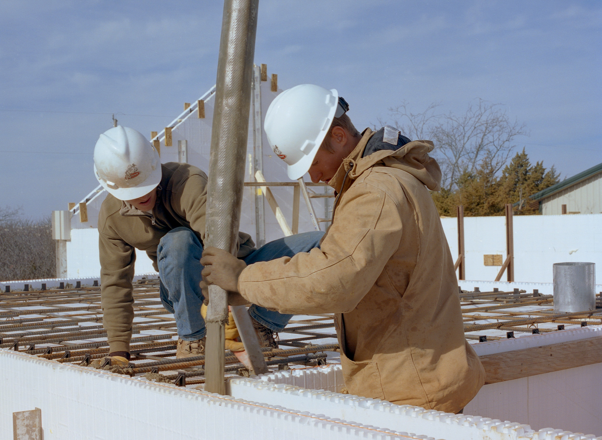ICF installers pouring concrete